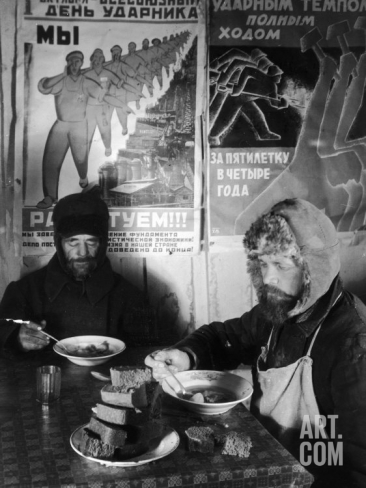 white-russian-workers-eating-black-bread-and-soup-at-table-with-soviet-communist-workers-posters-siberia